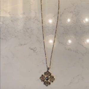 Gold medallion necklace with rhinestone detail